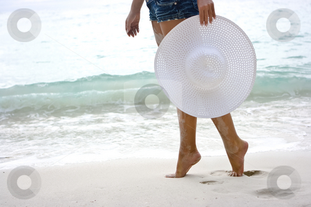 On the beach stock photo, Lady going on the beach with white hat by Dmitry Rostovtsev