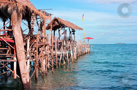 Wood old pier with huts stock photo, Wood old pier with huts on it in Thailand by Dmitry Rostovtsev