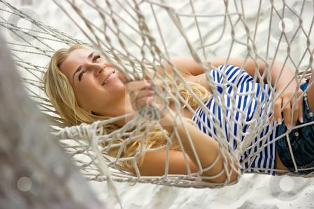 Hammock stock photo, Blonde girl relaxing in hammock on the sandy beach by Dmitry Rostovtsev