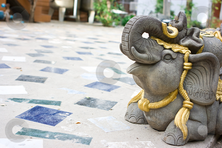 Decorative elephant stock photo, Decorative hand made elephant on the tiled floor by Dmitry Rostovtsev