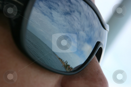 Reflection stock photo, Sea, sky and island reflected in sunglases by Dmitry Rostovtsev