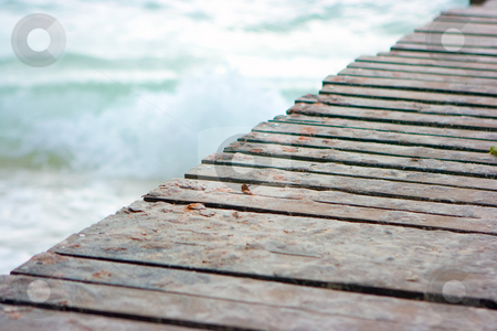 Wood pier stock photo, Wood pier on the beach by Dmitry Rostovtsev