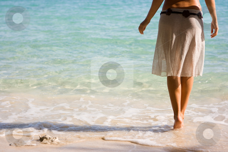 Girl on the beach stock photo, Slim young girl standing in the sea by Dmitry Rostovtsev