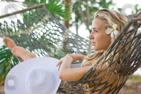 Girl on the hammock stock photo, Blonde girl with white flower in hair lying on the hammock by Dmitry Rostovtsev