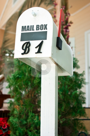 Mailbox stock photo, White decorative mailbox standing at the house by Dmitry Rostovtsev