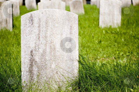 Blank Headstone stock photo, Blank headstone with grass growing at base. This was taken at a Cleveland cemetary in the veteran's section. by Stewart Behra