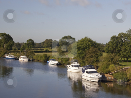 Boats on river in summer stock photo, A few boats on a river on a summers day by Mike Smith
