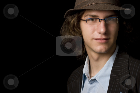 Teen with hat stock photo, Male teenager wearing a hat and glass by Yann Poirier
