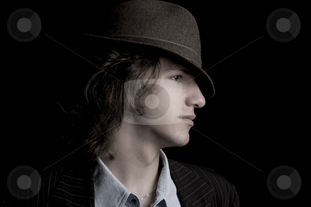 Profile of a teen with hat stock photo, Profile of a male teenager with a hat with desaturated effect by Yann Poirier