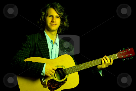 Folk guitar player stock photo, Male teenager folk guitar player, wearing a suit with a classical guitar by Yann Poirier
