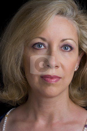 Head shot of a middle age women stock photo, Head shot of a women in her early fifties by Yann Poirier