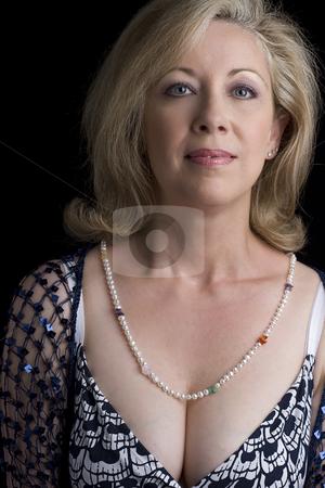 Portrait of a middle age women stock photo, Portrait of a women in her early fifties by Yann Poirier