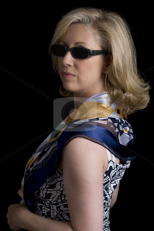 Fashionyta stock photo, Women in her early fifties looking over her shoulder wearing sunglass and a scarf by Yann Poirier