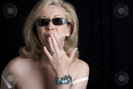 Oppsy Fashionyta stock photo, Women in her early fifties wearing sunglass in the middle of an opps expression by Yann Poirier