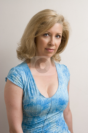 Portrait of a middle age women stock photo, Women in her early fifties with a little smile by Yann Poirier