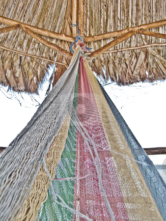 Multicolor hammock in a wooden hut with wind stock photo, Multicolor hammock in a wooden hut with wind by Vincent Demers