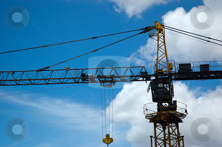 Crane stock photo, Heavy industrial crane with blue sky as background by Bayu Harsa