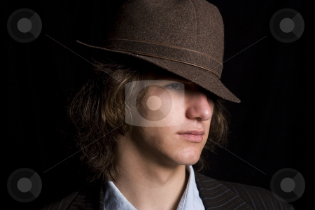 Gangster teen stock photo, Male teenager wearing a suit and hat with mad expression by Yann Poirier