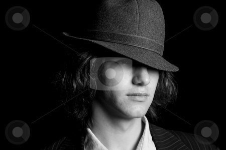Tearing up stock photo, Male teenager wearing a suit and hat with sad expression by Yann Poirier