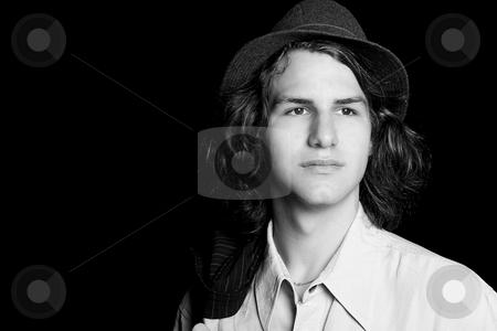 Teen wearing a  hat stock photo, Portrait of a male teenager wearing a hat by Yann Poirier