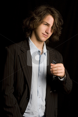 Hair in the way stock photo, Male teen wearing a casual suit with strain of hair in front of his eyes by Yann Poirier