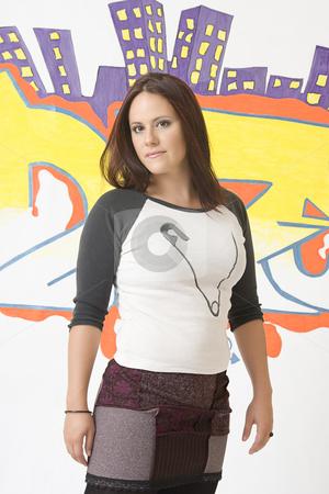 Urban girl stock photo, Teen girl in front of a graffiti by Yann Poirier