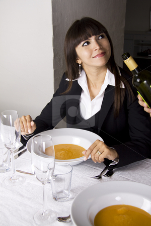 Lobster soup stock photo, Business woman is having lobster soup and white wine at a fine restaurant by Daniel Kafer