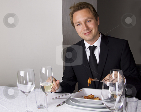 Business man is having lunch stock photo, Business man is having lunch at a frensh gourmet restaurant. by Daniel Kafer