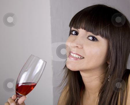 Young woman with red drink stock photo, Brazilian brunette female with a red drink in her hand by Daniel Kafer