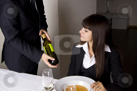Business woman is having lunch stock photo, Business woman is ordering wine at a fine restaurant by Daniel Kafer