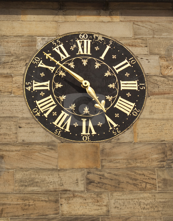 Old gilded clock on stone wall stock photo, Old gilded clock on stone wall in city by Mike Smith