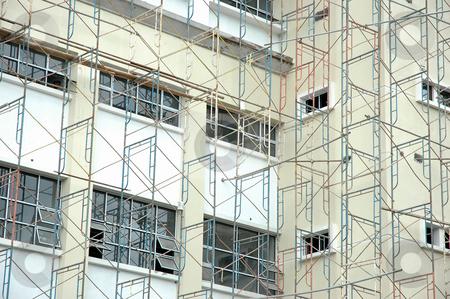Building under construction stock photo, New building under construction with many metal bar by Bayu Harsa