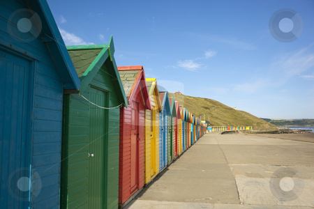Colourful beach huts stock photo, A row of colourful beach huts on the east coast of england by Mike Smith