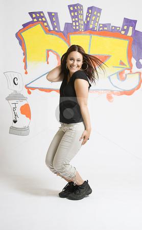 Break dancing girl posing stock photo, Late twenties break dancing girl in the middleof a cute pose by Yann Poirier
