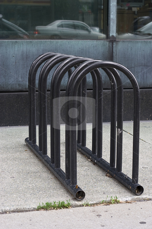 Empty bicycle rack stock photo, Empty bicycle rack on the side walk by Yann Poirier
