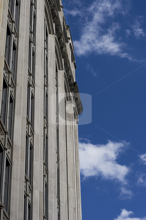 Side wall stock photo, Side wall of an old stone building on a clear day with some cloud by Yann Poirier