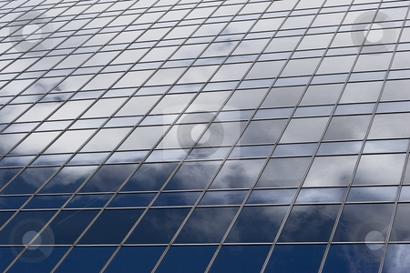Skycraper window stock photo, Close up of skycraper window reflecting a blue sky and clouds by Yann Poirier