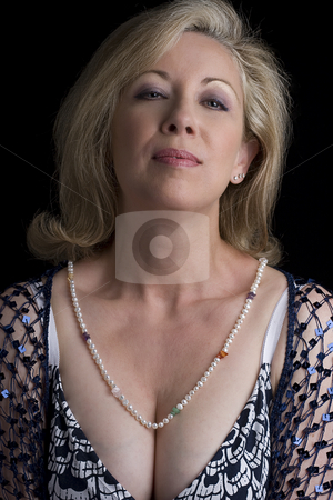 Smirking stock photo, Portrait of a women in her fifties with a smirk expression on her face by Yann Poirier