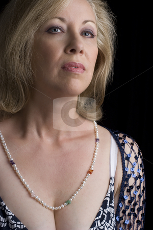 Disgusted stock photo, Women in her fifties with a disgusted expression by Yann Poirier