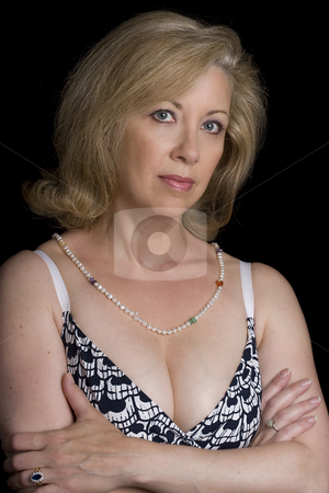 Looking serious stock photo, Women in her fifties with a serious expression by Yann Poirier