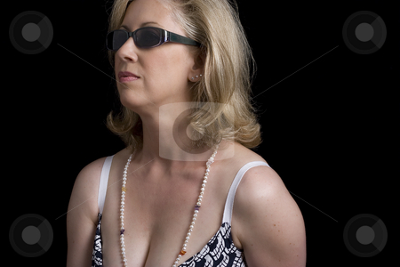 Fashionyta with sunglass stock photo, Women in her early fifties wearing sunglass by Yann Poirier