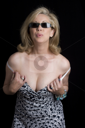 Fashionyta showing off asset stock photo, Women in her early fifties wearing sunglass acting like a tease for the camera by Yann Poirier