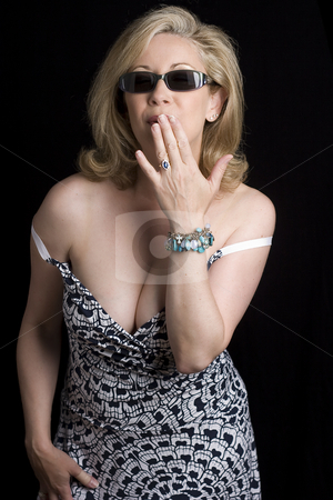 Naughty oops stock photo, Women in her early fifties with an oops expression as her dress is falling off by Yann Poirier
