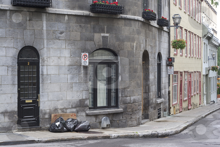 Street corner stock photo, Garbage day on a street corner of Old Quebec by Yann Poirier