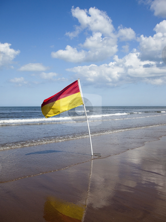 Flag on beach stock photo, A warning flag on a beach in summer by Mike Smith