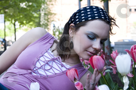 Smelling flowers stock photo, Teen girl smelling a tulip by Yann Poirier