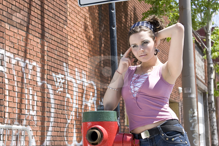 Posing by the fire hydrant stock photo, Teen girl posing by a fire hydrant by Yann Poirier