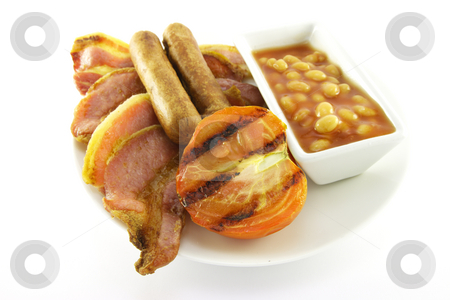 Breakfast and Beans stock photo, Slices of crispy pork bacon with half a grilled tomato, two thin pork sausages and a small dish of baked beans on a white round plate with a white background by Keith Wilson