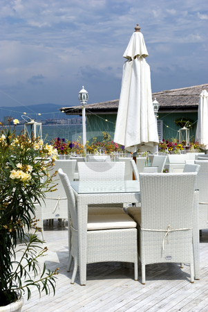 Greek restaurant setting stock photo, Romantic restaurant in greek style by Desislava Dimitrova