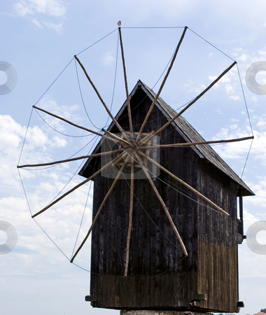 Windmill stock photo, Old wooden windmill symbol of Nesebar Bulgaria by Desislava Dimitrova